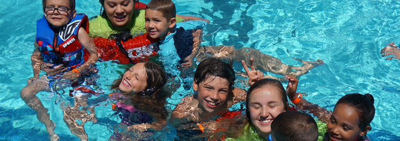 local children enjoying a sunny day at the Walter Graham Aquatic Center in Vacaville.